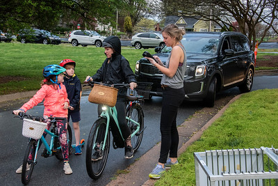 Dora takes an order from coffee and donut fans on two wheels. (Bill Giduz photo)