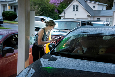 Dora Callahan was one of six employees taking and filling orders as Summit Coffee paired up with Kindred to offer bread milk doughnuts and coffee at the old bank drive-thru on S. Main Street.