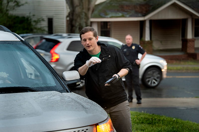 Davidson police help ease the traffic as Wes Fogg takes an order. (Bill Giduz photo)