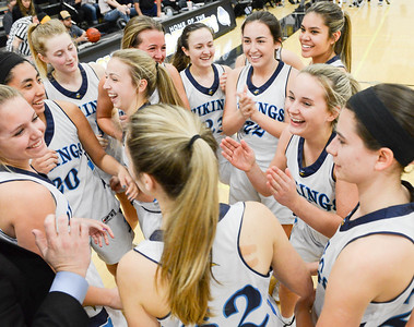 The Pleasant Valley High girls basketball team is all smiles after its 48-33 victory over Enterprise in the Northern Section Division III championship game Friday at Butte College. (Matt Bates -- Enterprise-Record)