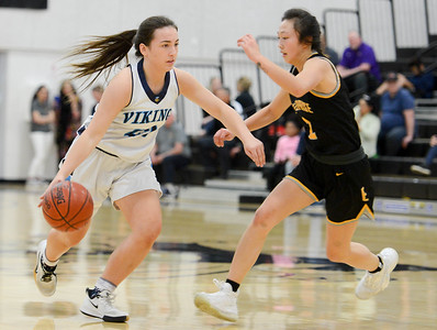 Pleasant Valley's Rebekah Horn (left) drives past Enterprise's Mianna Saechao (right) during the Northern Section Division III championshp game at Butte College's Cowan Gym. (Matt Bates -- Enterprise-Record)