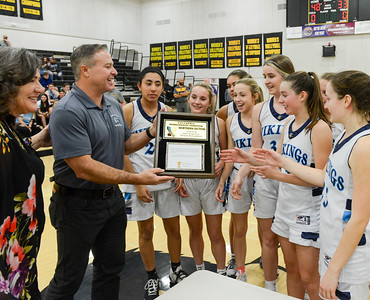 The Pleasant Valley girls basketball team receive the Division III championship plaque after their 48-33 victory over Enterprise on Friday, February 28, 2020, in Butte Valley, California. (Matt Bates -- Enterprise-Record)