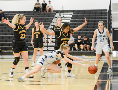 Pleasant Valley's Kylie Matthews dives for a loose ball in front of Enterprise's Natayah Saeturn during the Northern Section Division III championship game at Butte College. (Matt Bates -- Enterprise-Record)
