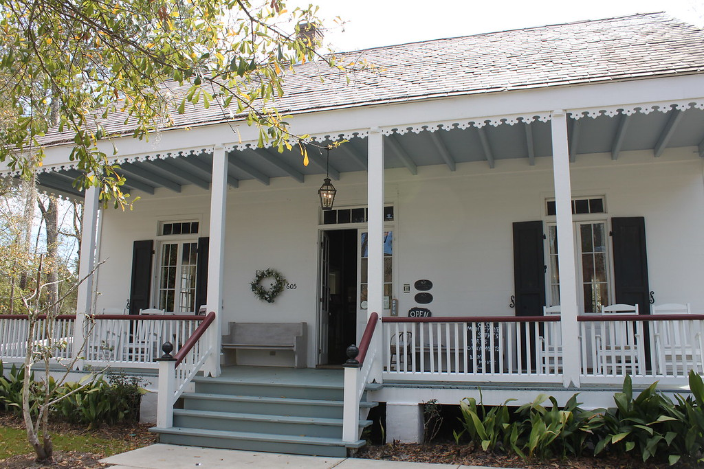 Jean Baptiste Lang Creole House Museum, a white home with a large wide porch