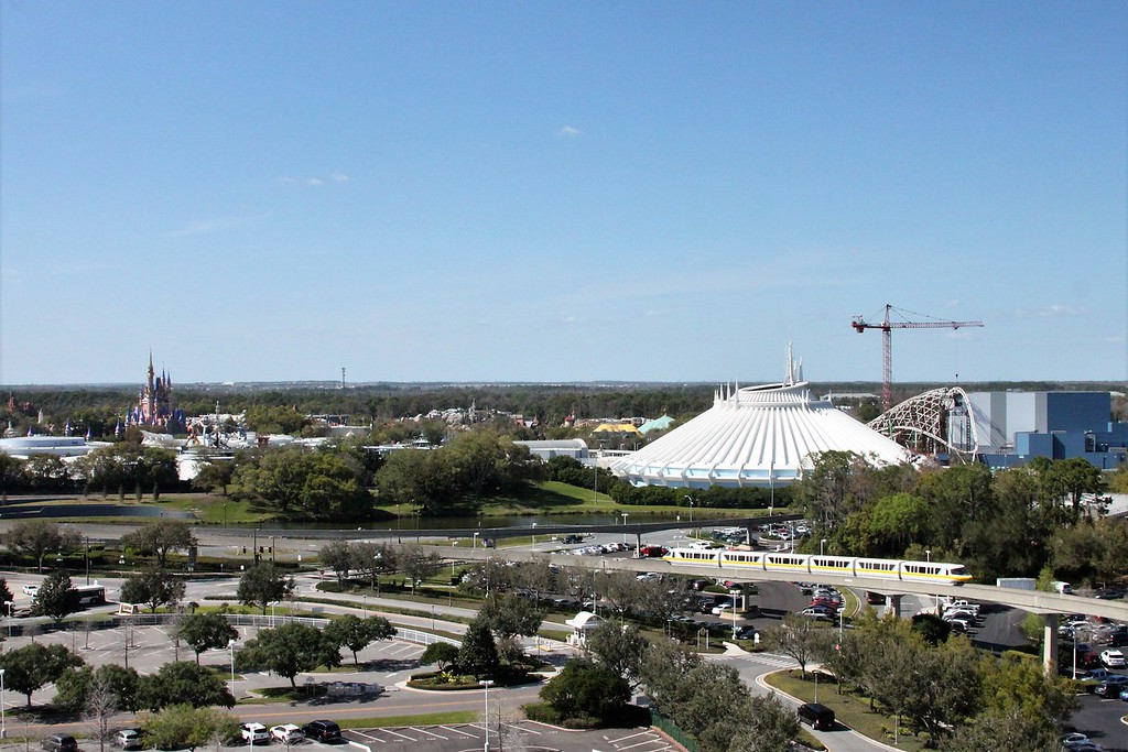 A track features the Disney monorail near the Magic Kingdom castle