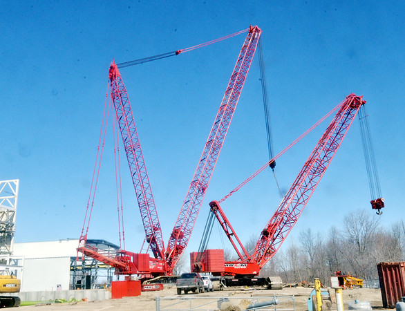 WARREN DILLAWAY / Star Beacon TWO CRANES are ready to place a large compressor at the site of Cristal Global plant on Middle Road in Ashtabula Township.