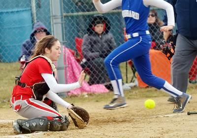 WARREN DILLAWAY / Star Beacon MO LYNCH of Edgewood waits for a late throw on Monday as Athena Smith of Hubbard scores during a game at North Kingsville Little League Field.
