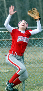 WARREN DILLAWAY / Star Beacon ASHLEY EVANS of Edgewood runs into  the fence while chasing a fly ball that flew over the fence for a Hubbard grand slam on Monday afternoon at North Kingsvilleeee LIttle League Field.