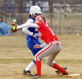 WARREN DILLAWAY / Star Beacon SAM BLASHINSKY of Edgewood grabs a late throw on Monday as Lea Munnell of Hubbard arrives safely back at second base during a game at North Kingsville Little League Field.