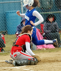WARREN DILLAWAY / Star Beacon MO LYNCH of Edgewood grabs a late throw on Monday as Athena Smith of Hubbard scores during a game at North Kingsville Little League Field.