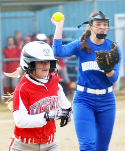 WARREN DILLAWAY / Star Beacon TAYLOR ROWE (left) of Edgewood dashes to first base as Addy Jarvis of Hubbard  prepares to throw her out on Monday during a game at North Kingsville Little League Field.