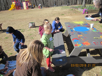 Painting picnic talbes at SES