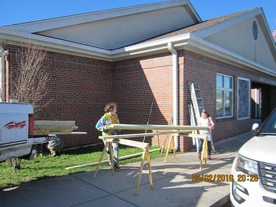Unloading lumber for the bike shelter at MES