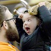 KEVIN HARVISON  <br /> Chris Hitchcock, left watches as his daughter, Anslee Hitchcock reacts during a showing of the Junior Livestock Show at Pittsburg County Fairgrounds.