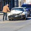 KEVIN HARVISON  <br /> A motor vehicle accident is photographed at Carl Albert Expressway and First Street Friday morning.