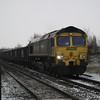 66610 on 6M06 Middleton Towers - Basford Hall sand heads across Norwood Rd LC, march on 19th Jan 2013