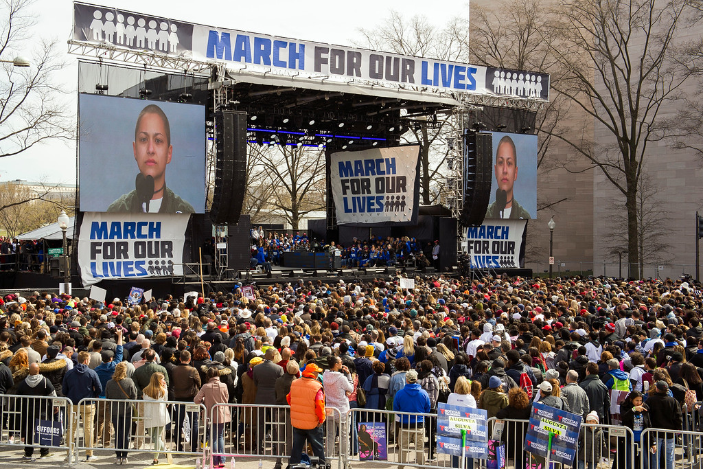 """. Marjory Stoneman Douglas High School student Emma Gonzalez addresses the \""""March for Our Lives\"""" rally in support of gun control in Washington, Saturday, March 24, 2018, on Pennsylvania Avenue near the U.S. Capitol. (AP Photo/Cliff Owen)"""