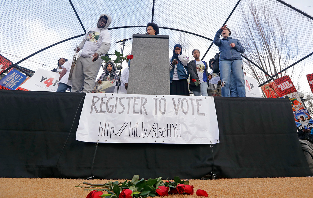 . High school students toss roses in memory of those lost to gun violence in front of the stage during a rally before a march in favor of gun control Saturday, March 24, 2018, in Seattle. Summoned to action by student survivors of the Florida school shooting, hundreds of thousands of teenagers and their supporters rallied in the nation\'s capital and cities across America on Saturday to press for gun control in one of the biggest youth protests since the Vietnam era. (AP Photo/Elaine Thompson)