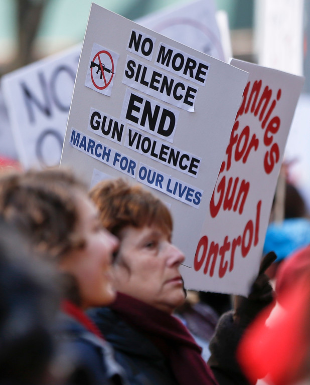 ". People gather with signs as they attend a ""March for Our Lives\"" rally in support of gun control, Saturday, March 24, 2018, in Pittsburgh. (AP Photo/Keith Srakocic)"