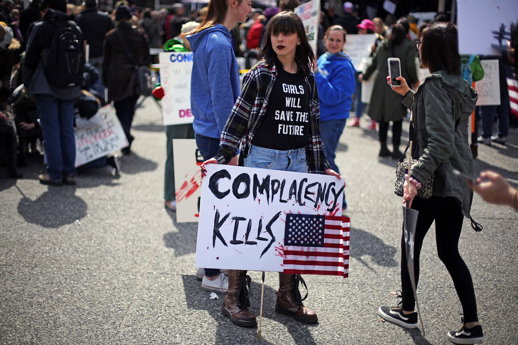. Renae Roscart, a junior at West Allegheny High School near Pittsburgh, holds a sign she brought to a Gun Control Rally in downtown Pittsburgh, Saturday, March 24, 2018. (AP Photo/Gene J. Puskar)