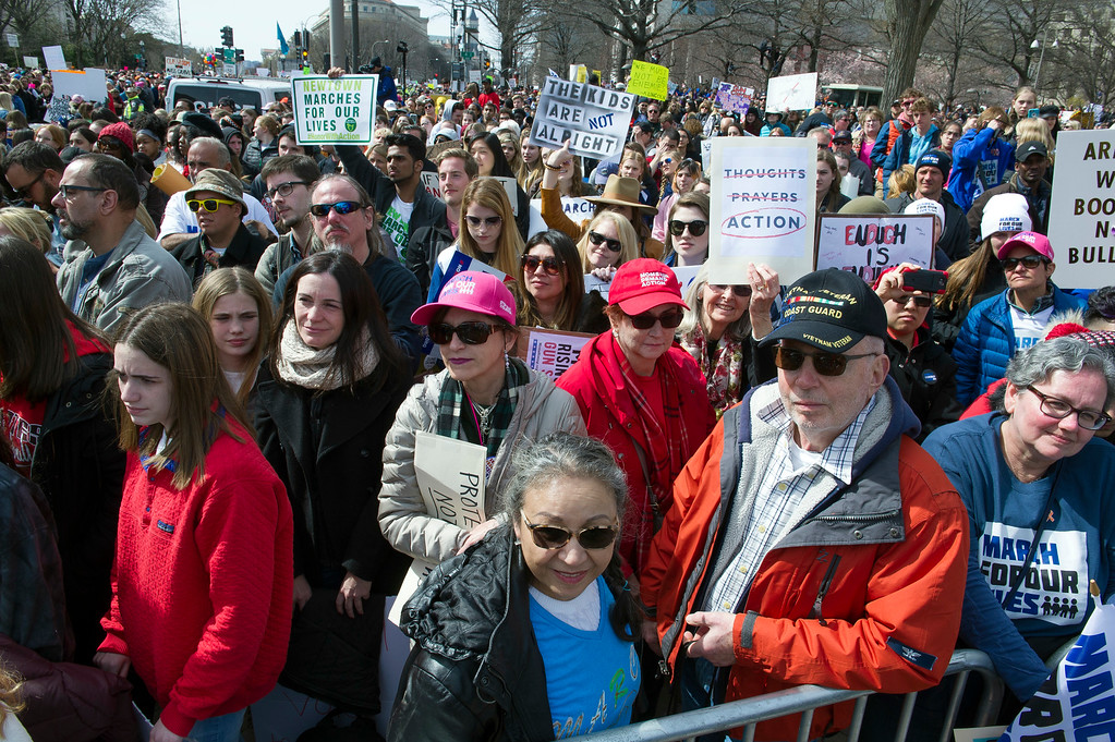 ". Protesters attend the ""March for Our Lives\"" rally in support of gun control in Washington, Saturday, March 24, 2018, on Pennsylvania Avenue near the U.S. Capitol, in Washington. (AP Photo/Cliff Owen)"