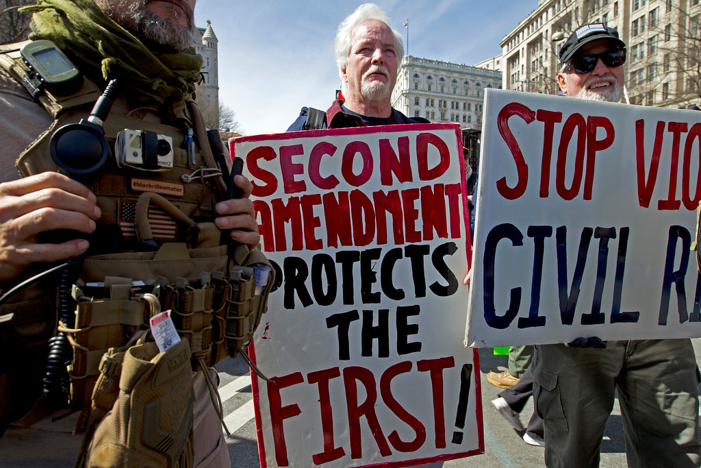 """. Pro-gun demonstrators protest during the \""""March for Our Lives\"""" rally in support of gun control in Washington, Saturday, March 24, 2018, on Pennsylvania Avenue near the U.S. Capitol. (AP Photo/Jose Luis Magana)"""
