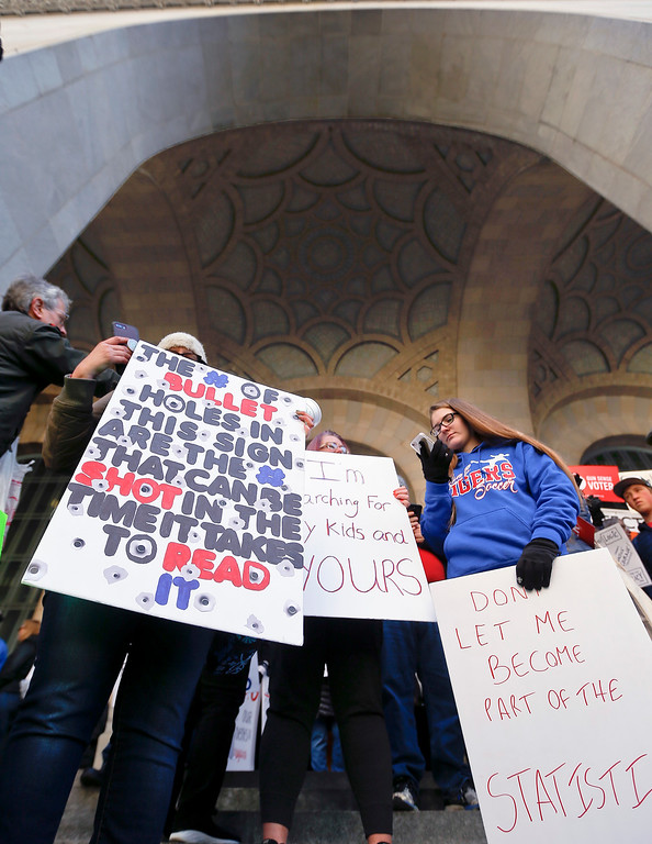 """. Some of the crowd attending a \""""March for Our Lives\"""" rally gather in the portico of the Pittsburgh City-County Building before they march in support of gun control, Saturday, March 24, 2018, . (AP Photo/Keith Srakocic)"""