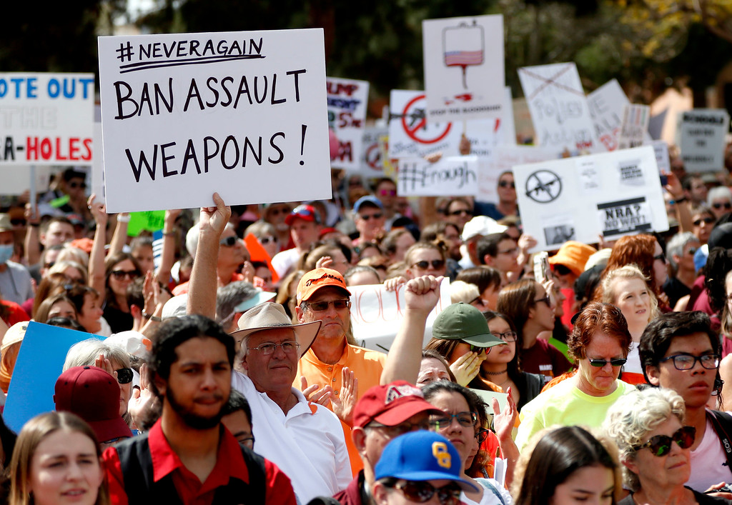 ". People participate in a ""March For Our Lives\"" rally at the state Capitol, Saturday, March 24, 2018, in Phoenix. Students and activists across the country planned events Saturday in conjunction with a Washington march spearheaded by teens from Marjory Stoneman Douglas High School in Parkland, Fla., where over a dozen people were killed in February. (AP Photo/Matt York)"