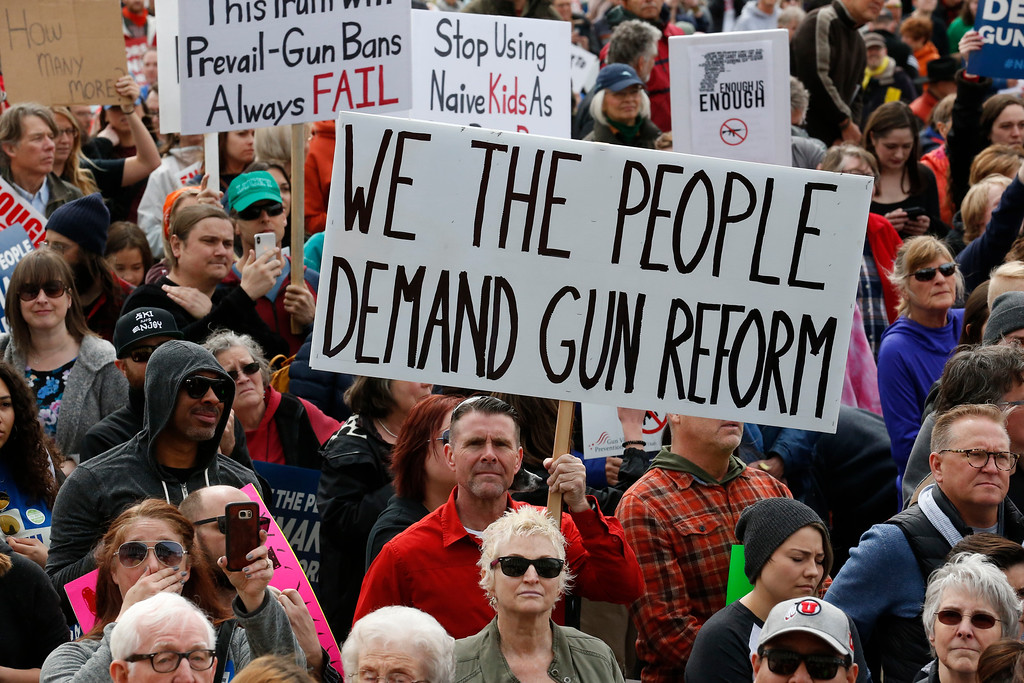 . Thousands of protesters flood the Utah State Capitol on Saturday, March 24, 2018, in Salt Lake City, seeking stronger gun-control measures in response to last month\'s school shooting in Parkland, Fla. (AP Photo/Rick Bowmer)