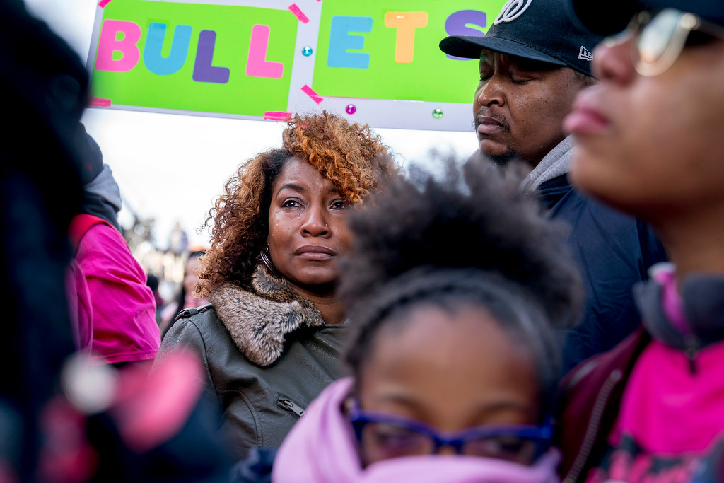 ". Taurica Haskins is comforted by her husband Alden Haskins Jr., as they arrive at the ""March for Our Lives\"" rally in support of gun control in Washington, Saturday, March 24, 2018. They were among family attending in memory of college bound Jamahri Sydnor, 17, who was shot to death in August 2017, in Washignton. (AP Photo/Andrew Harnik)"