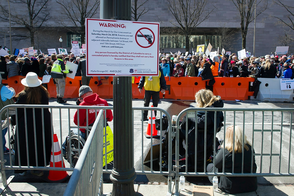 """. A sign on Pennsylvania Avenue informs protesters that firearms are not allowed during the \""""March for Our Lives\"""" rally in support of gun control in Washington, Saturday, March 24, 2018, near the U.S. Capitol. (AP Photo/Cliff Owen)"""