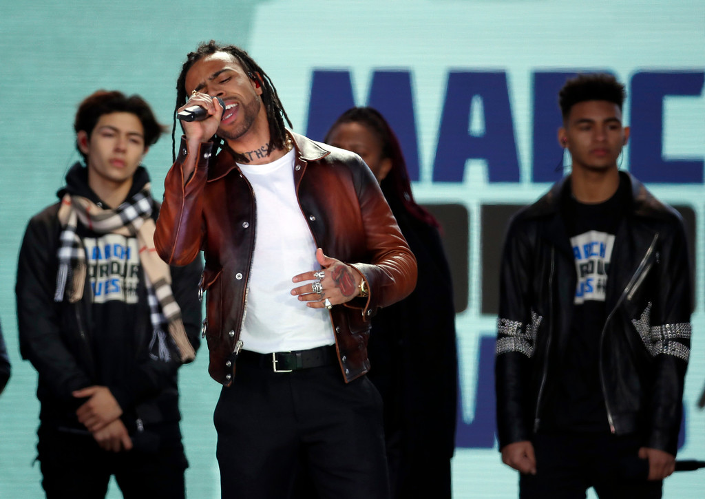 ". Vic Mensa performs ""We Could Be Free\"" during the \""March for Our Lives\"" rally in support of gun control, Saturday, March 24, 2018, in Washington. (AP Photo/Alex Brandon)"