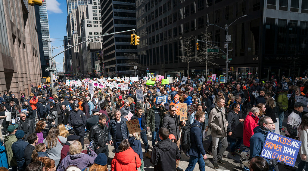 . People taking part in a march against gun violence walk along 6th Avenue in New York Saturday, March 24, 2018. (AP Photo/Craig Ruttle)