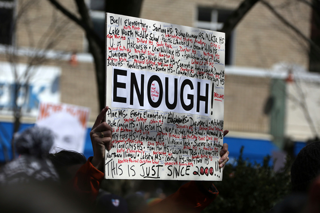 . A person holds a sign during a Gun Control Rally in Market Square in downtown Pittsburgh Saturday, March 24, 2018. (AP Photo/Gene J. Puskar)