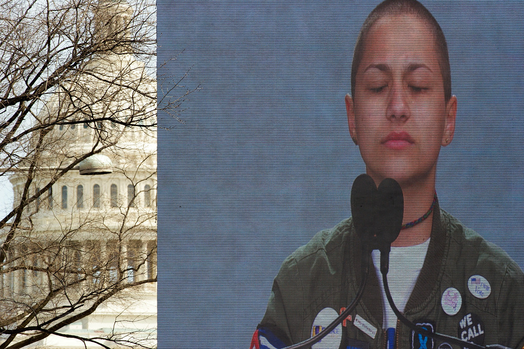 ". With the U.S. Capitol behind the stage, Marjory Stoneman Douglas High School student Emma Gonzalez, is seen on a video screen, as she stands silently at the podium at the ""March for Our Lives\"" rally in support of gun control in Washington, Saturday, March 24, 2018, on Pennsylvania Avenue near the U.S. Capitol. (AP Photo/Cliff Owen)"