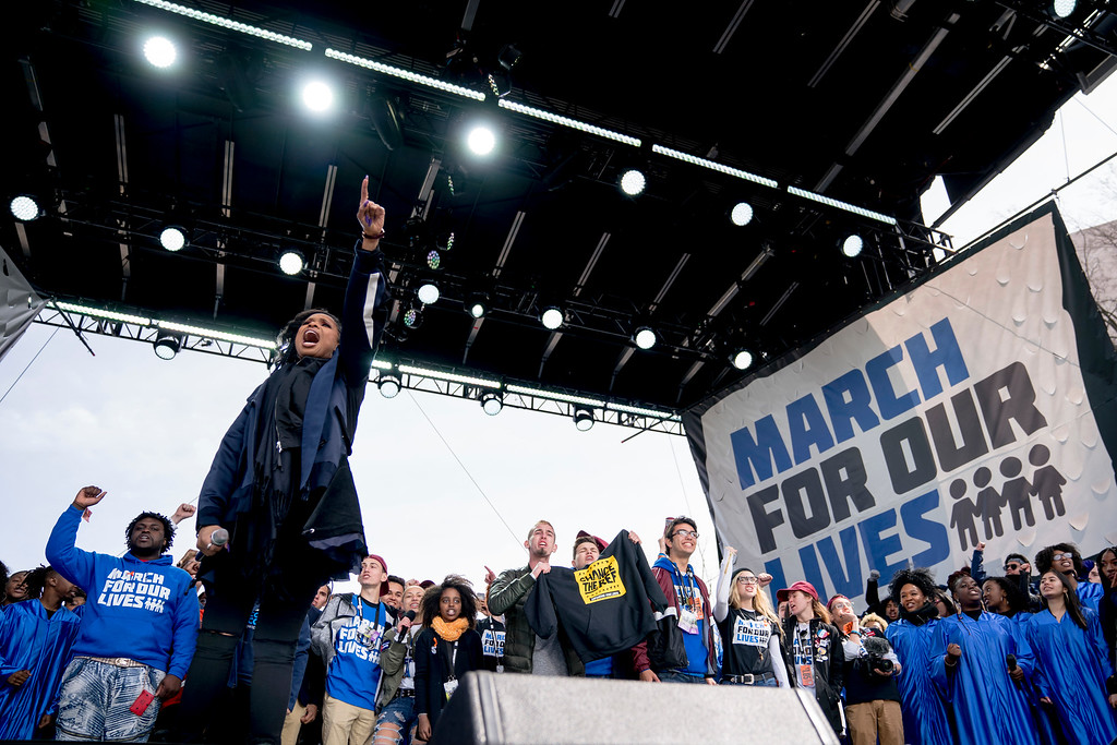". Jennifer Hudson, center, accompanied by Marjory Stoneman Douglas High School students gather on stage to end the ""March for Our Lives\"" rally in support of gun control in Washington, Saturday, March 24, 2018. (AP Photo/Andrew Harnik)"