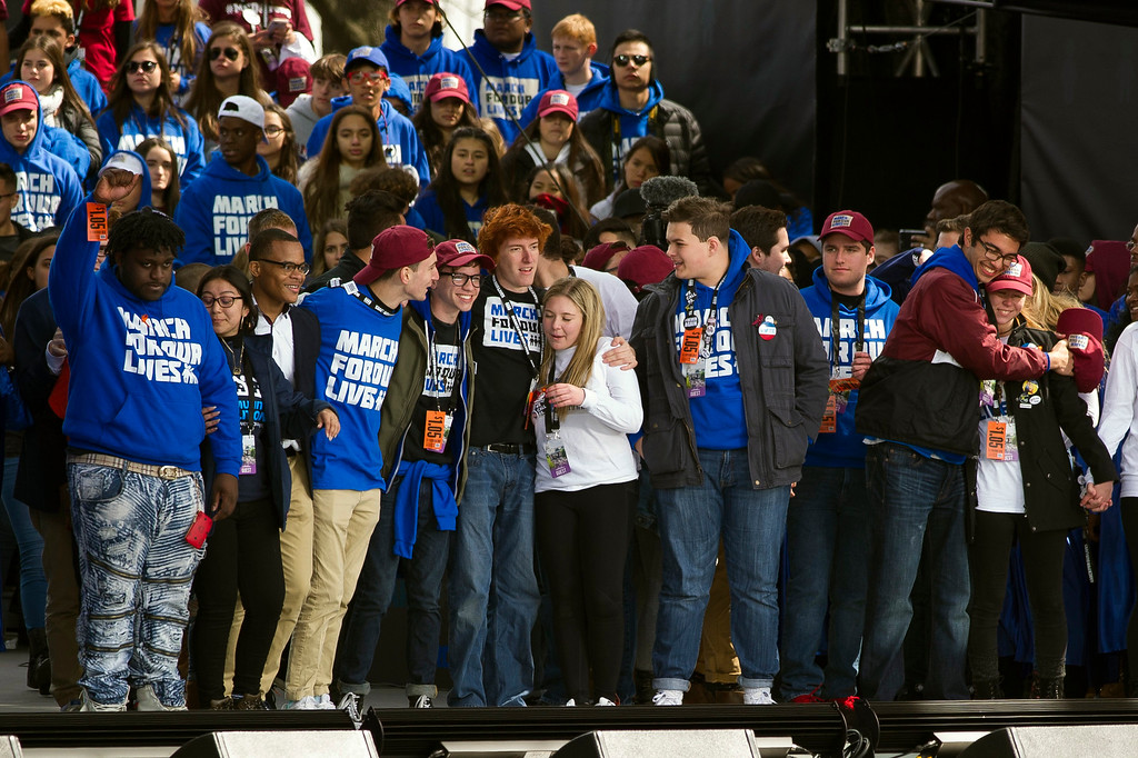". Students who spoke at the ""March for Our Lives\"" rally in support of gun control hug onstage, in Washington, Saturday, March 24, 2018, on Pennsylvania Avenue near the U.S. Capitol in Washington. (AP Photo/Cliff Owen)"