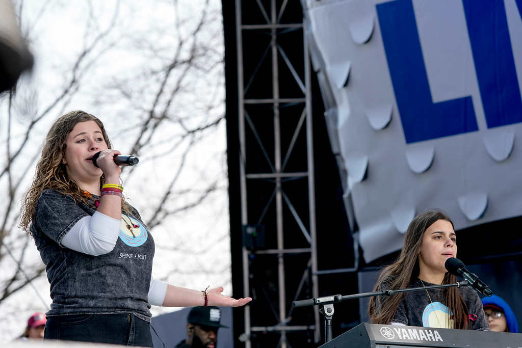 """. The Stoneman Douglas High School drama club and the student choir perform the song \""""Shine\"""" during the \""""March for Our Lives\"""" rally in support of gun control in Washington, Saturday, March 24, 2018. (AP Photo/Andrew Harnik)"""
