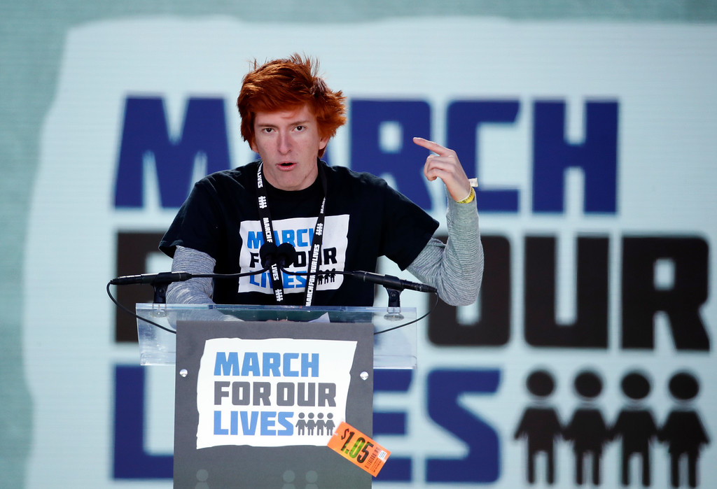 ". Student Ryan Deitsch, a survivor of the mass shooting at Marjory Stoneman Douglas High School in Parkland, Fla., speaks during the ""March for Our Lives\"" rally in support of gun control, Saturday, March 24, 2018, in Washington. (AP Photo/Alex Brandon)"