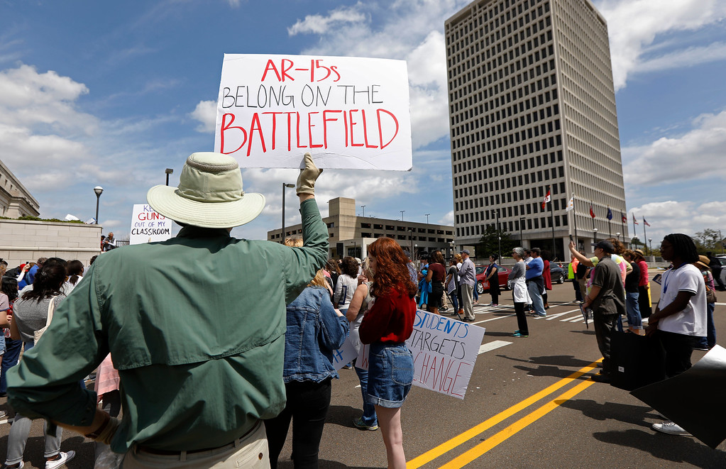 ". People participate in a ""March for Our Lives\"" rally in Jackson, Miss., Saturday, March 24, 2018. Students and activists across the country planned events Saturday in conjunction with a Washington march spearheaded by teens from Marjory Stoneman Douglas High School in Parkland, Fla., where over a dozen people were killed in February. (AP Photo/Rogelio V. Solis)"