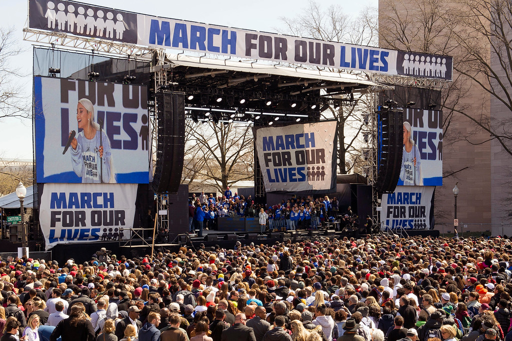 ". Ariana Grande performs at the ""March for Our Lives\"" rally in support of gun control in Washington, Saturday, March 24, 2018, on Pennsylvania Avenue near the U.S. Capitol. (AP Photo/Cliff Owen)"