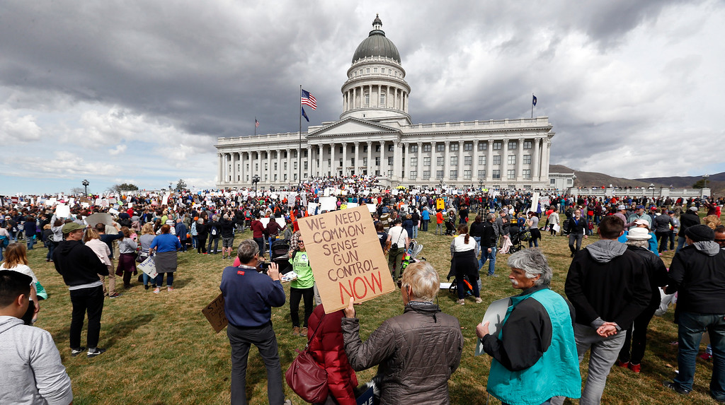 . Thousands of protesters flood the Utah State Capitol Saturday, March 24, 2018, in Salt Lake City,  seeking stronger gun-control measures in response to last month\'s school shooting in Parkland, Fla.,The rallies came 10 days after thousands of students held walkouts to protest gun violence and honor the 17 people killed in the Florida school shooting. (AP Photo/Rick Bowmer)