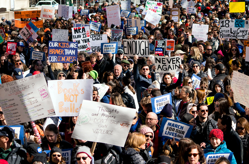 . People take part in a march rally against gun violence Saturday, March 24, 2018, in New York. Tens of thousands of people poured into the nation\'s capital and cities across America on Saturday to march for gun control and ignite political activism among the young.  (AP Photo/Craig Ruttle)
