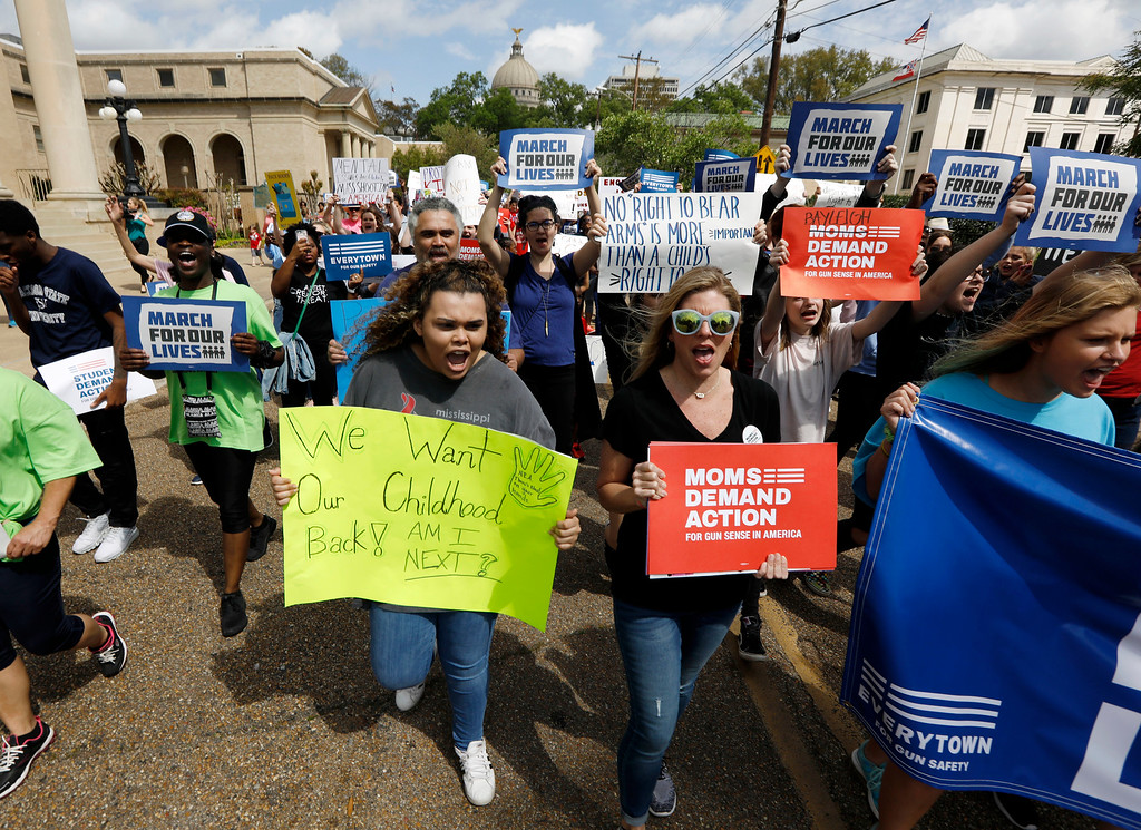 ". Several hundred students, parents, concerned citizens and anti-gun advocates marched in downtown Jackson, Miss., Saturday, March 24, 2018, to demand stricter gun laws in the U.S. The rally was one of several being held across Mississippi and the United States. Protesters held signs and chanted as they marched from the Mississippi State Supreme Court to the Governor\'s Mansion and back again to the building across from the state Capitol where the Legislature was in session, for the ""March for Our Lives\"" rally. (AP Photo/Rogelio V. Solis)"