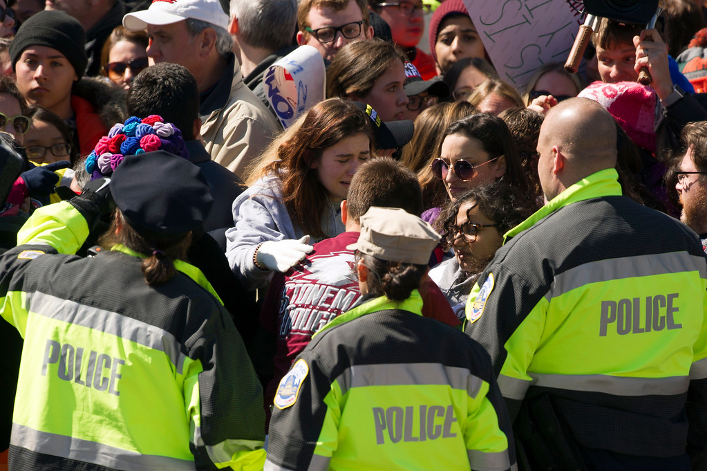 """. A young women is carried out of a fenced-in area at the \""""March for Our Lives\"""" rally in support of gun control in Washington, Saturday, March 24, 2018, on Pennsylvania Avenue near the U.S. Capitol. (AP Photo/Cliff Owen)"""