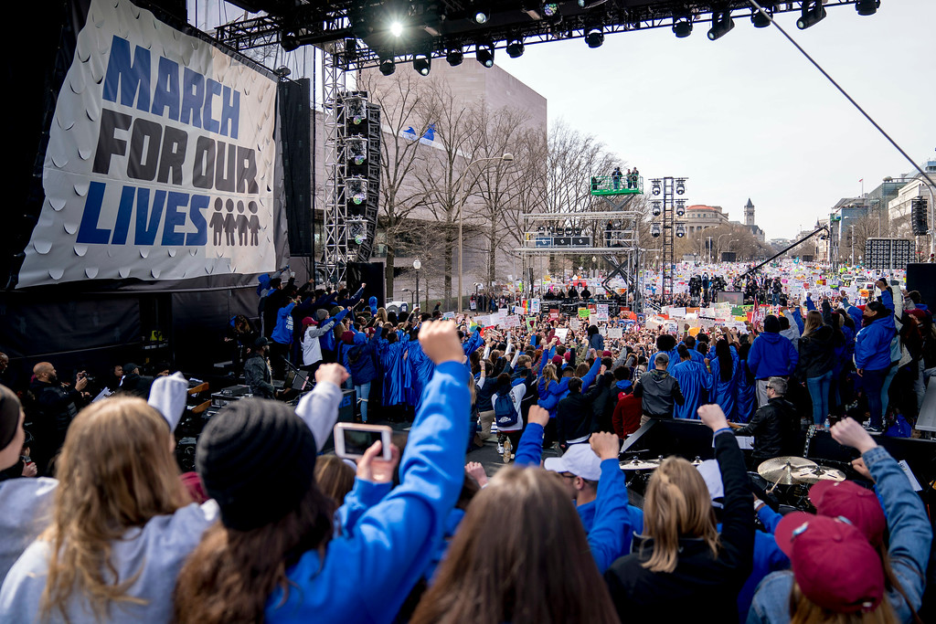 """. Marjory Stoneman Douglas High School students on stage hold up clenched fists at the end of the \""""March for Our Lives\"""" rally in support of gun control in Washington, Saturday, March 24, 2018. (AP Photo/Andrew Harnik)"""