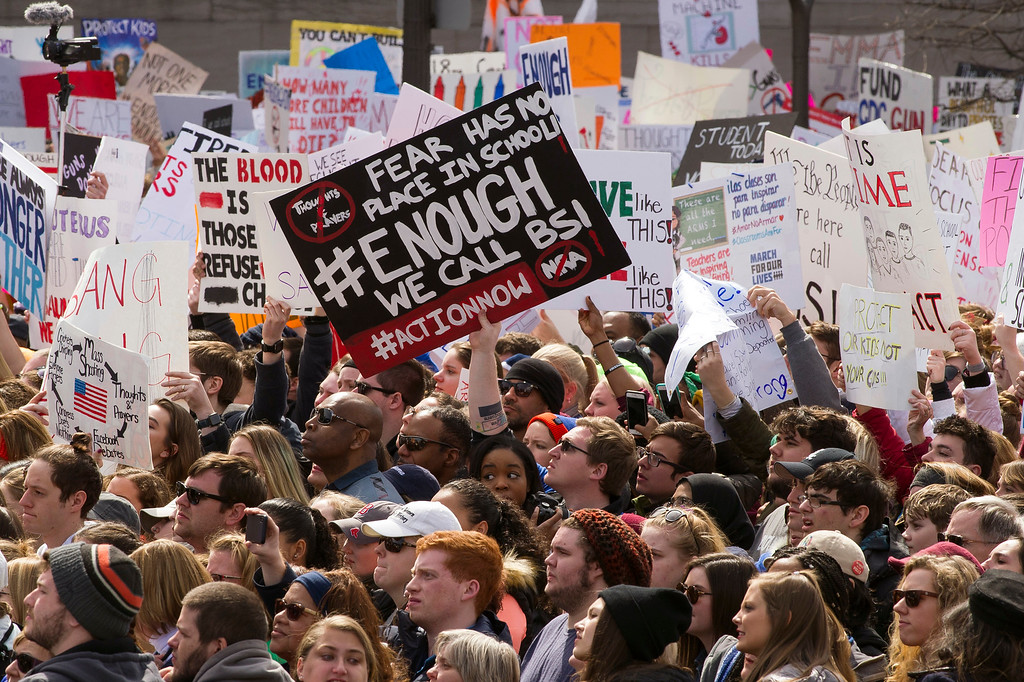 """. Protesters attend the \""""March for Our Lives\"""" rally in support of gun control in Washington, Saturday, March 24, 2018, on Pennsylvania Avenue near the U.S. Capitol. (AP Photo/Cliff Owen)"""