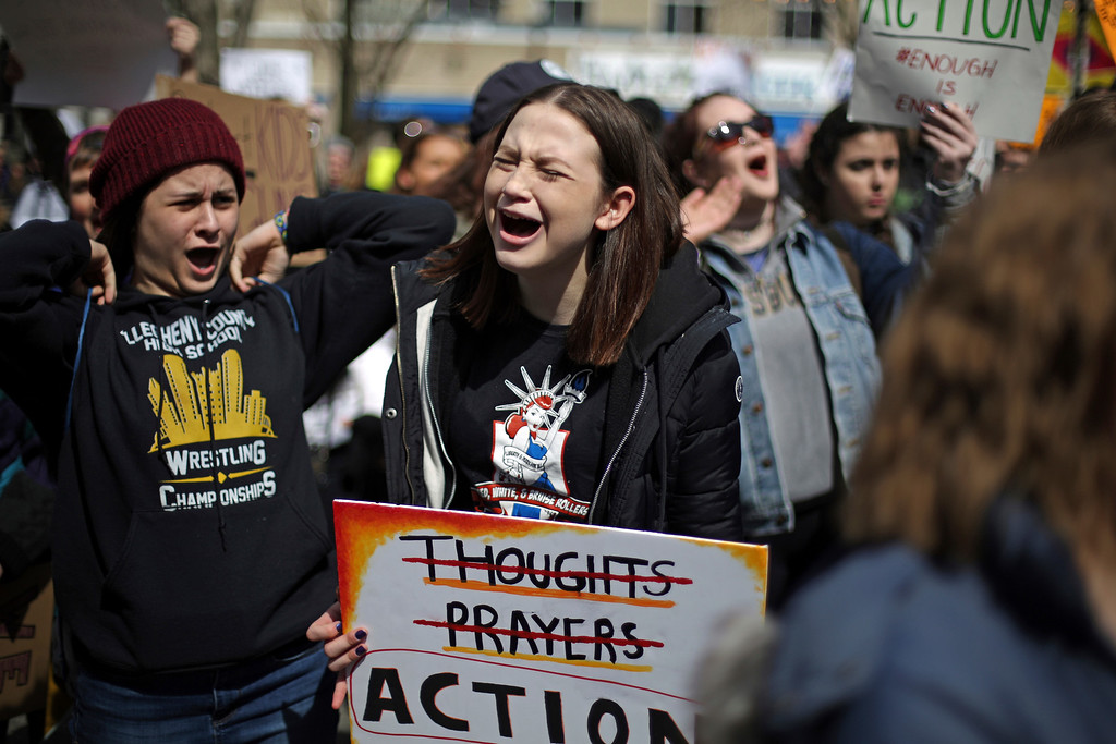 . Amanda Ostroff, a freshman at Fox Chapel, Pa., high school attends a gathering in Market Square in downtown Pittsburgh at the end of a gun control rally Saturday, March 24, 2018. (AP Photo/Gene J. Puskar)