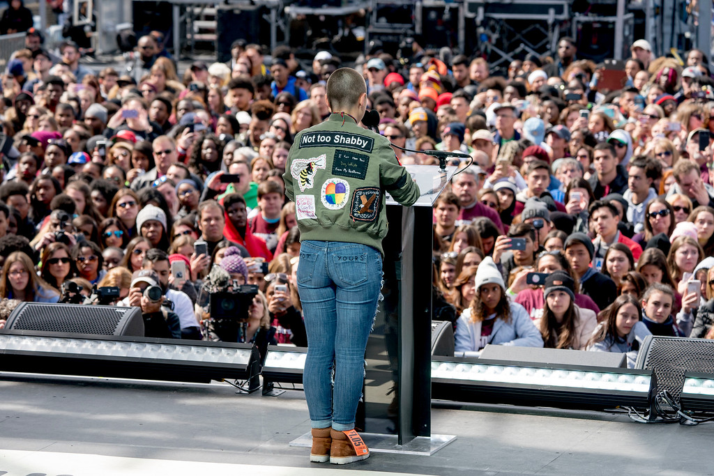 """. Emma Gonzalez, a survivor of the mass shooting at Marjory Stoneman Douglas High School in Parkland, Fla., speaks during the \""""March for Our Lives\"""" rally in support of gun control in Washington, Saturday, March 24, 2018. (AP Photo/Andrew Harnik)"""