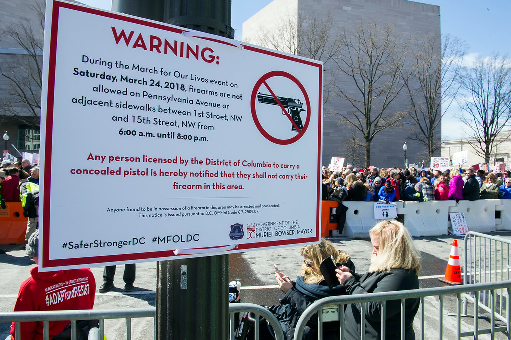 ". A sign on Pennsylvania Avenue tells protesters that firearms are not allowed during the ""March for Our Lives\"" rally in support of gun control in Washington, Saturday, March 24, 2018, near the U.S. Capitol. (AP Photo/Cliff Owen)"